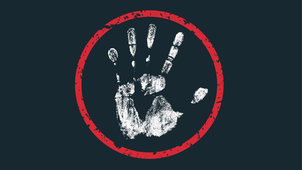 A white hand print on a black background