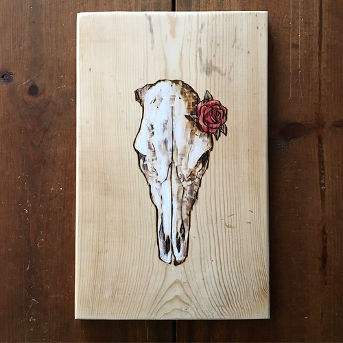 Cow skull in pyrography and acrylic.
