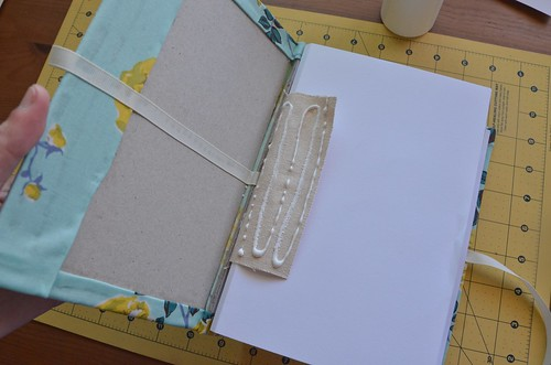 31. Glue canvas strip to book board.