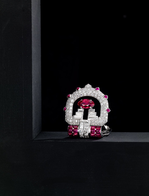 A fine ruby and diamond clip brooch, Cartier, circa 1935 132