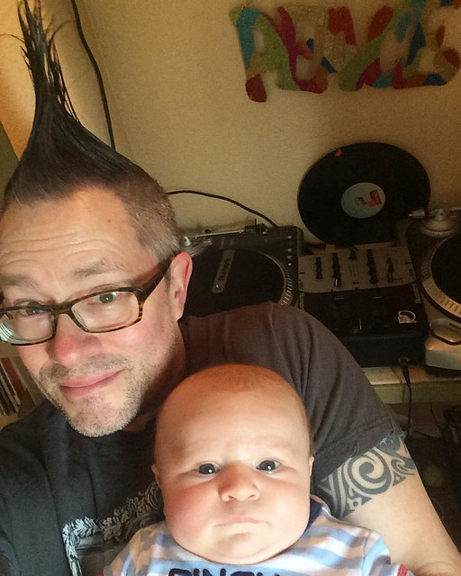 Joshy' self-portrait with baby and turntables. 💕