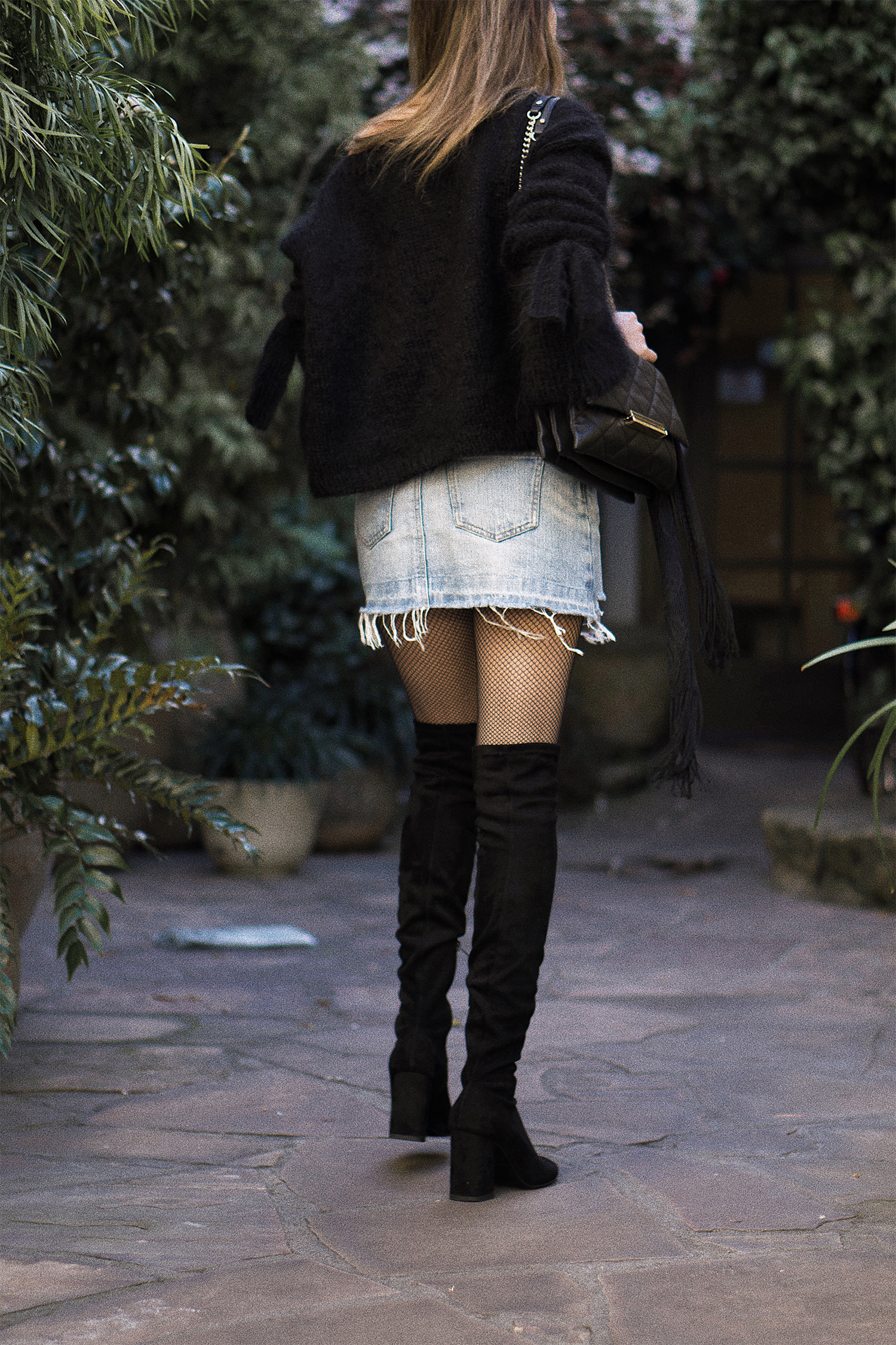 self knitted sweater and ripped denim skirt