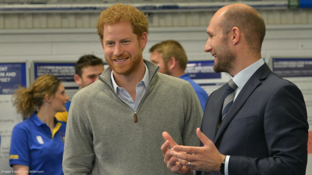 Prince Harry talks to Professor Keith Stokes