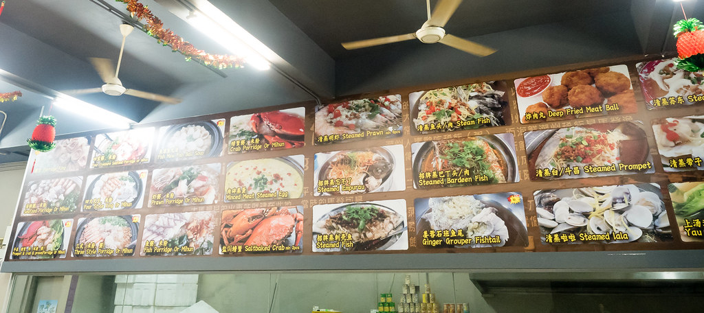 Big food menu with clear photos on the wall