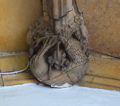 Porch boss: raven with a vine leaf (15th Century)