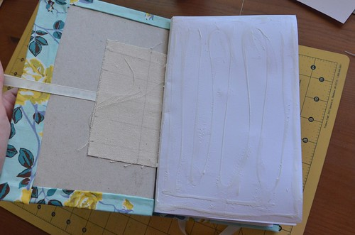 32. Glue card stock endpaper over canvas strip and onto book board and cloth.