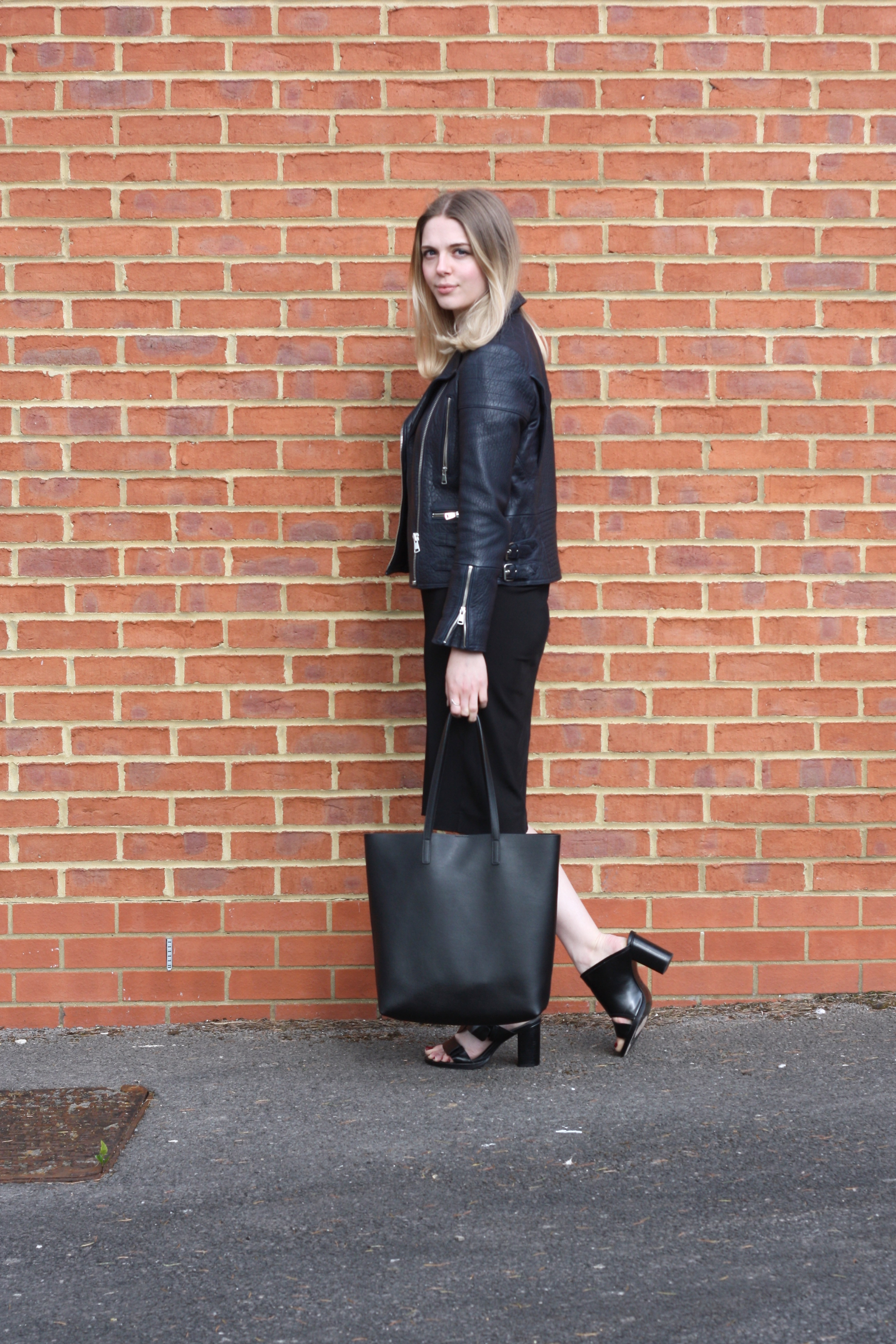 Saint Laurent black medium shopper bag, & Other Stories black midi dress and & Other Stories black heels