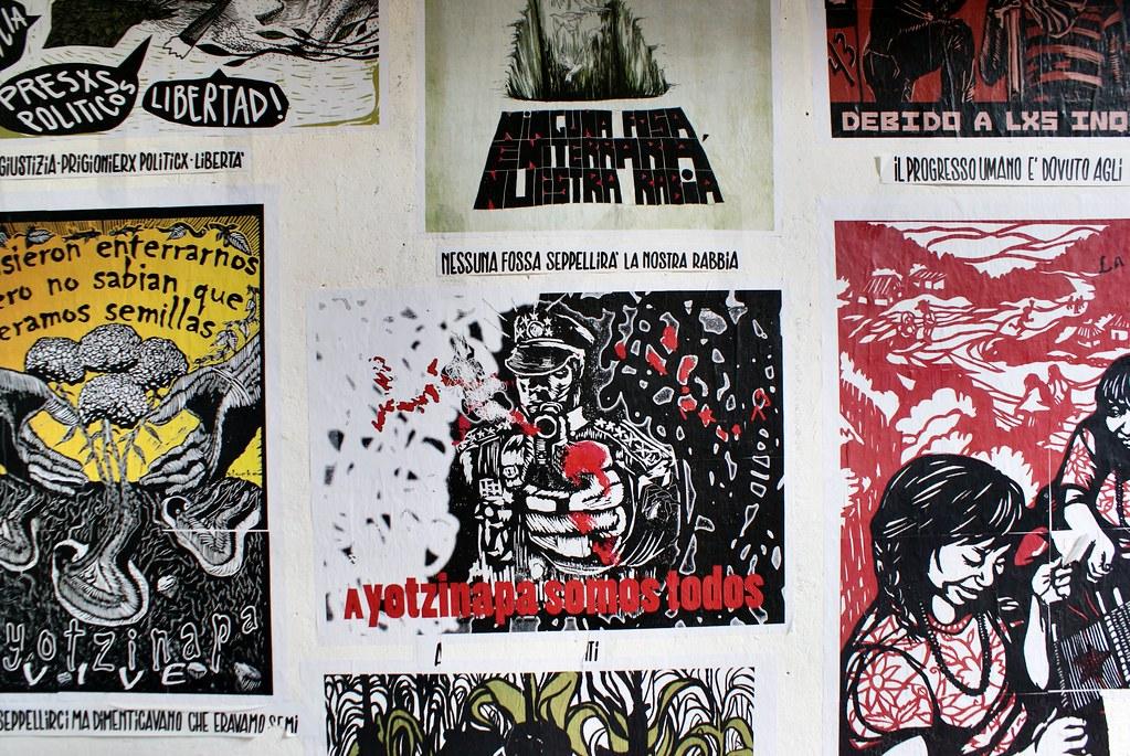 Affiches dans le squat culturel du XM24 à Bologne.