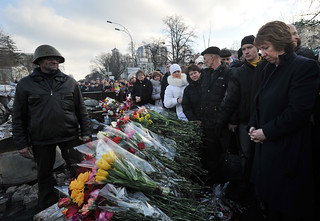 Catherine Ashton lays flowers at the barricades of Independence square, Kiev. | by European External Action Service - EEAS