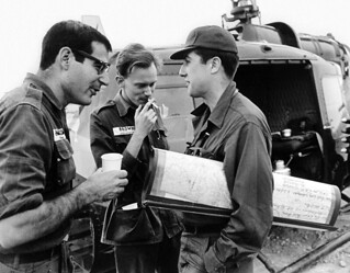 ca. 1964 David Halberstam, Malcolm Browne and Neil Sheehan chat beside a helicopter in Vietnam | by manhhai