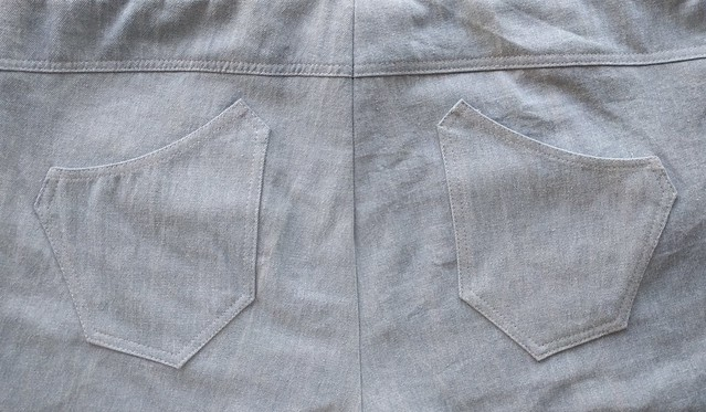 Back view of jeans yoke with unusual curved pockets.