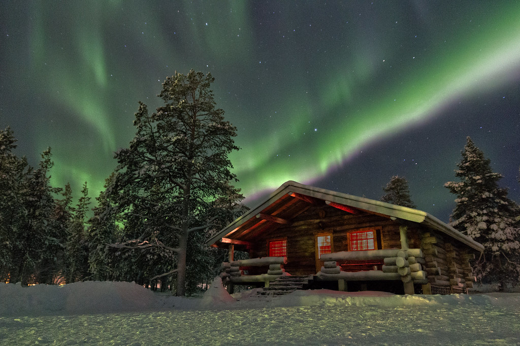 Northern Lights Above A Cottage Location Lapland