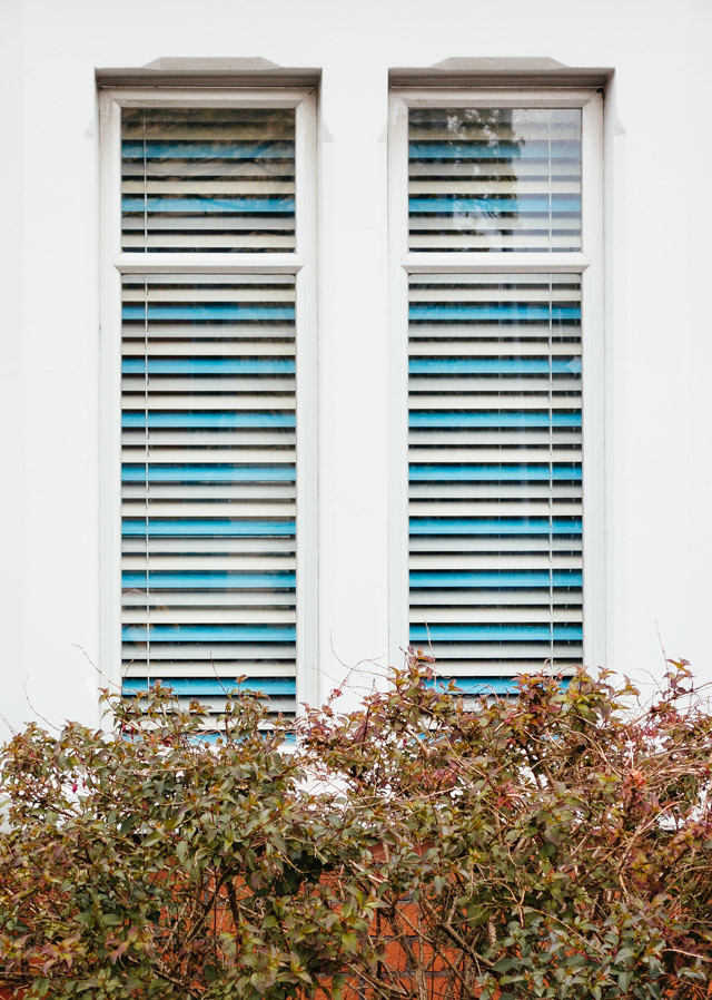 window with blue and white blinds