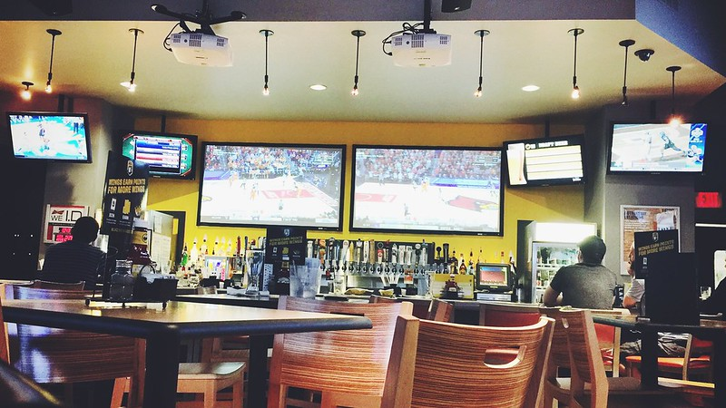 Inside a Buffalo Wild Wings restaurant during March Madness basketball games