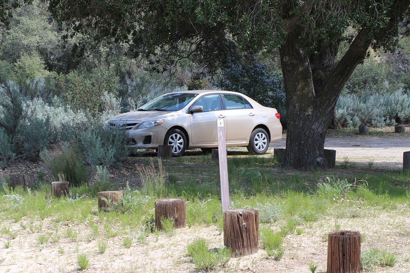 There's our car at the Boulder Oaks Campground, with a small PCT trail marker in front of it