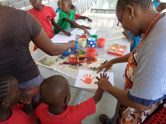 Madam Pauline oversees the children's creative skills