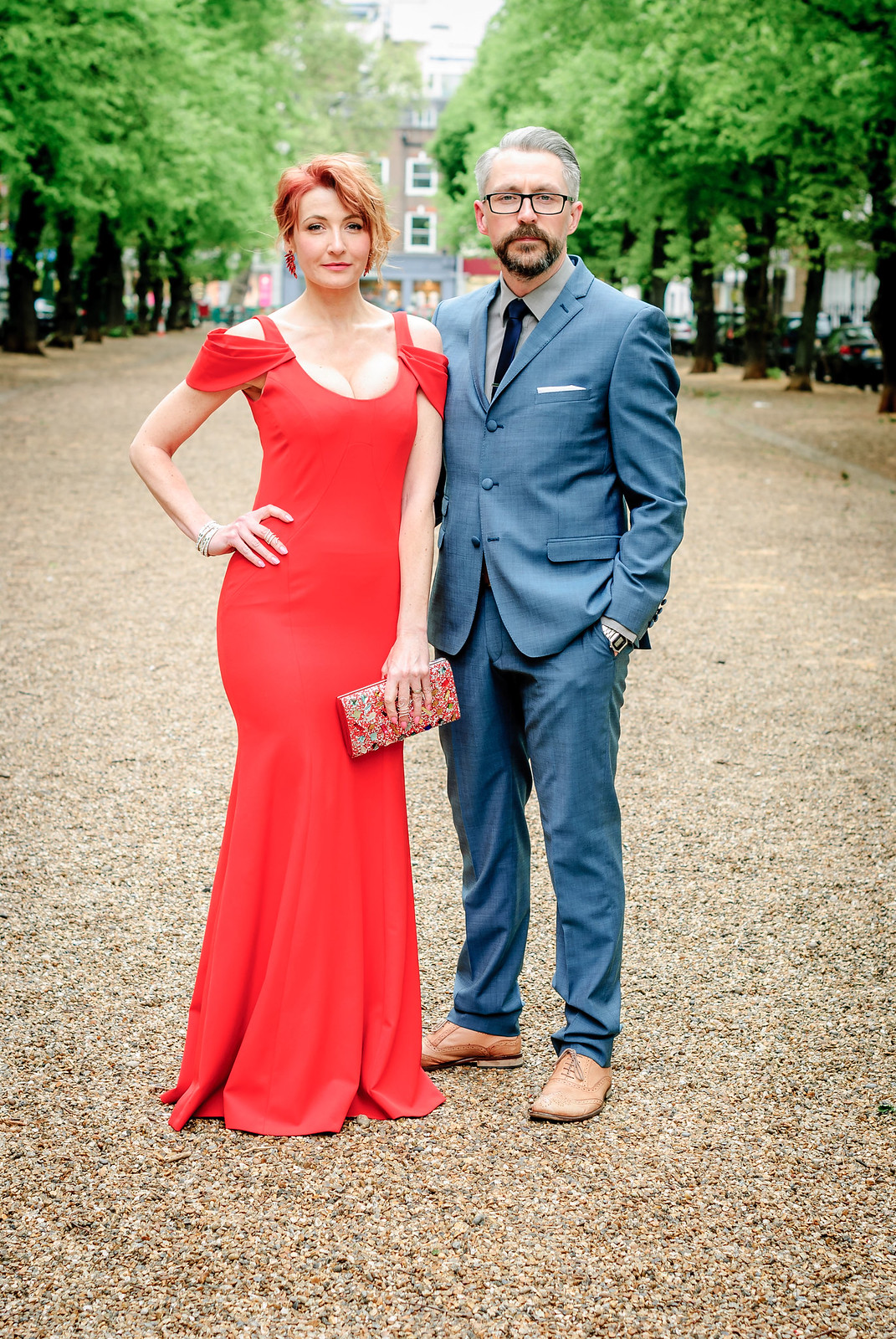 Awards ceremony outfit - Her: Long red fitted gown with shoulder detail Him: Mid blue suit with dark tie and tan brogues | Not Dressed As Lamb, over 40 style