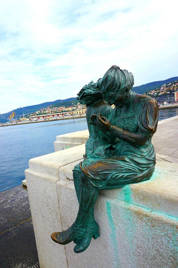 Bronze statue perched along Trieste's Barcola