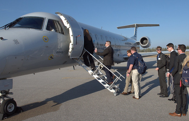 Auburn students board an American Eagle jet at the Auburn University Regional Airport.