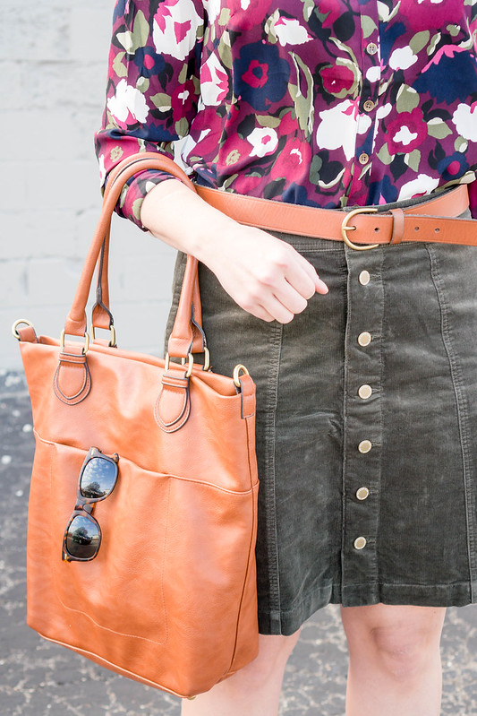 purple floral print blouse + dark green cord skirt + nude patent wedges + madewell cognac belt + target cognac tote; spring work outfit | Style On Target blog