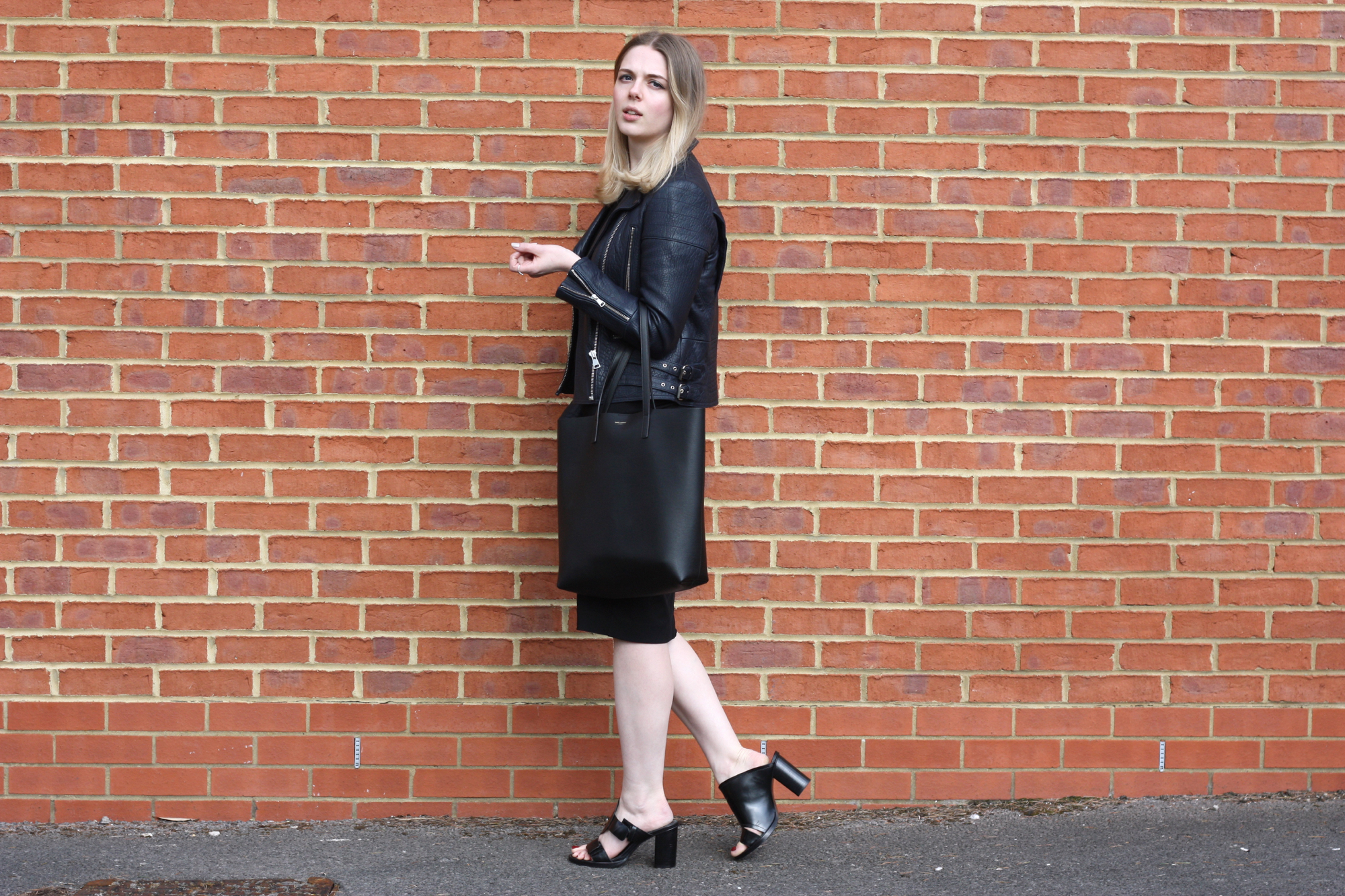 Whistles navy leather jacket, & Other Stories black midi dress and & Other Stories black mules