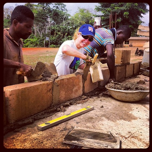 Our volunteer Sue Hillman lays blocks to the new school we are building in Abenta Village, Ghana. | by villagebyvillage