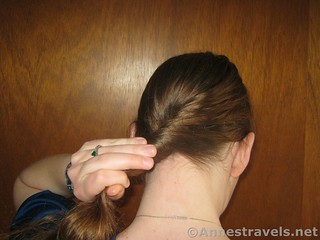 Begin to twist the hair to make a Hair Elastic Twist Up - 12 Hiking Hairstyles that are Pretty & Practical