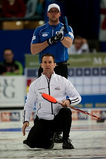 Brad Gushue keeps an eye on the line while Ryan Harnden looks on | by seasonofchampions