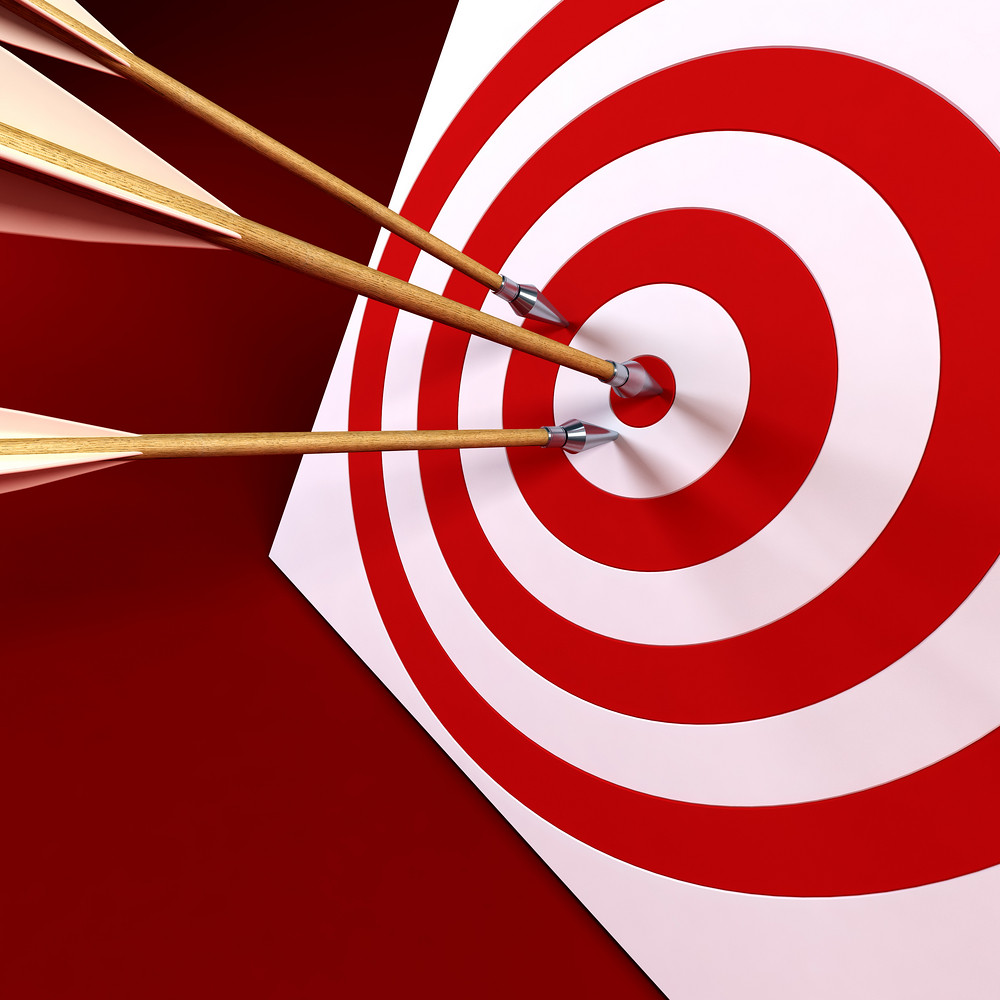 Photo of target with arrows in bulls-eye