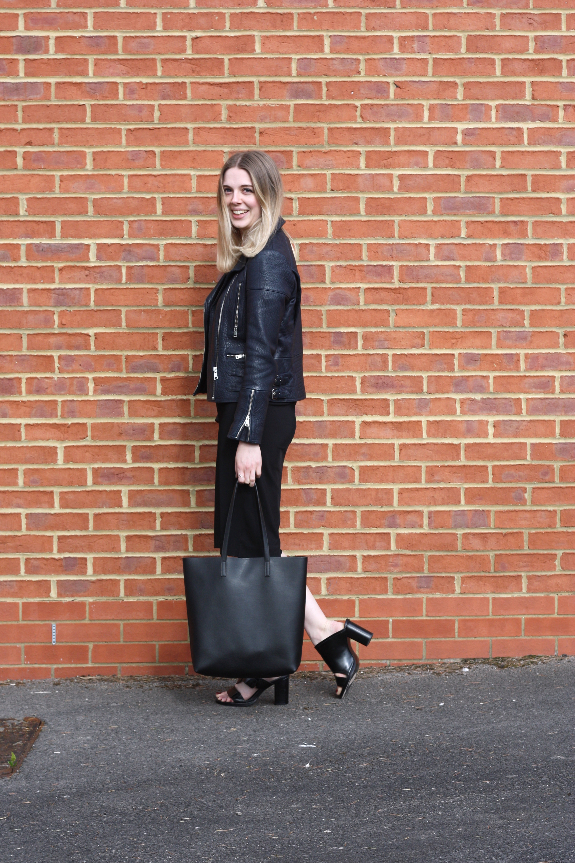 & Other Stories black mules, Whistles navy leather jacket and Saint Laurent black tote