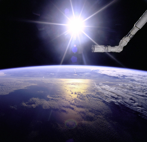 Robot Arm Over Earth with Sunburst | by NASA on The Commons
