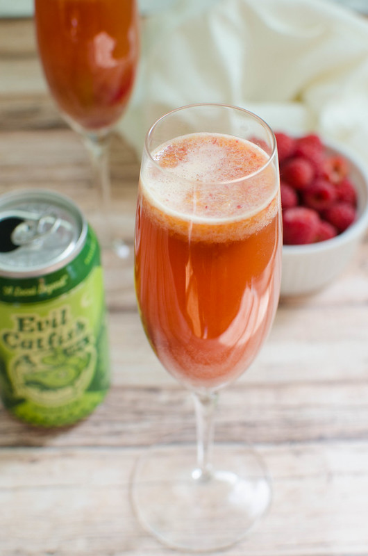 Raspberry Beermosas - the perfect brunch cocktail for beer lovers! Fresh raspberries, orange juice, and your fave beer make the most delicious beer cocktail!