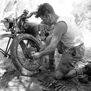 Private F. Jones of The Royal Canadian Regiment repairing his motorcycle near Militello, Italy, August 18, 1943 / Le soldat F. Jones du Royal Canadian Regiment répare sa motocyclette près de Militello (Italie), le 18 août 1943 | by BiblioArchives / LibraryArchives