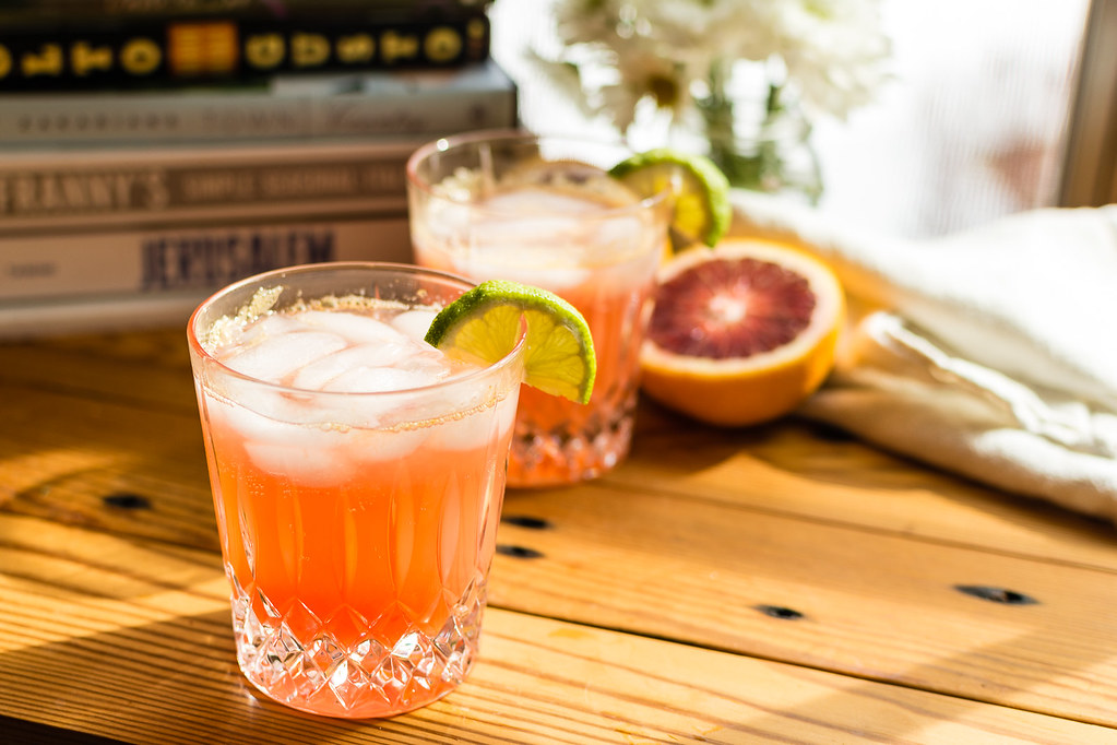 Blood Orange Paloma Spritzer - a quick and easy refreshing cocktail with tequila, fresh juice, and 7UP. Turn brunch - or anytime - up a notch.