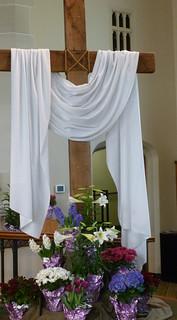 white draped cross on Easter Sunday