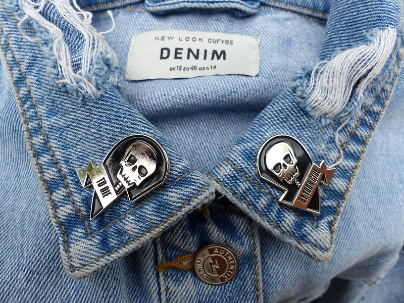 this is a picture of a enamel pin with smiths lyrics