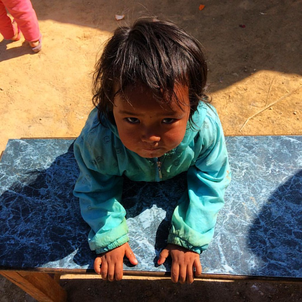 Kids across are adorable. She was just going about her business of playing and being curious around us yesterday while we were going about our work. This village was recovering from #earthquake and many houses had moved into tin recovery shelters. The #sc