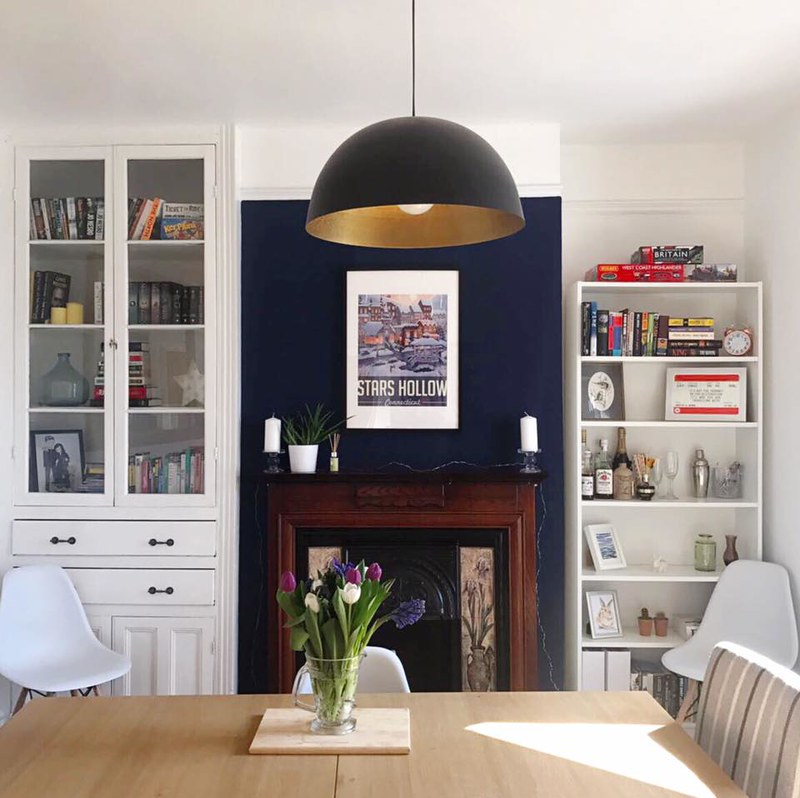 this s a picture of my dining room with a navy blue feature wall
