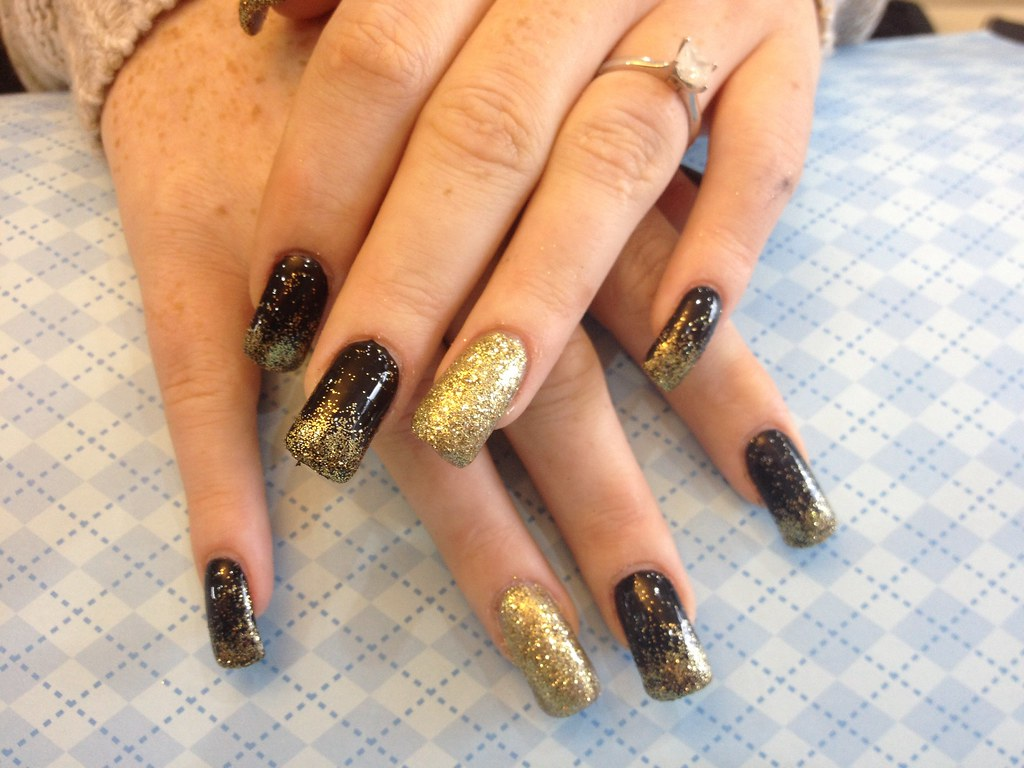 Acrylic nails with black gel polish an gold glitter | Flickr