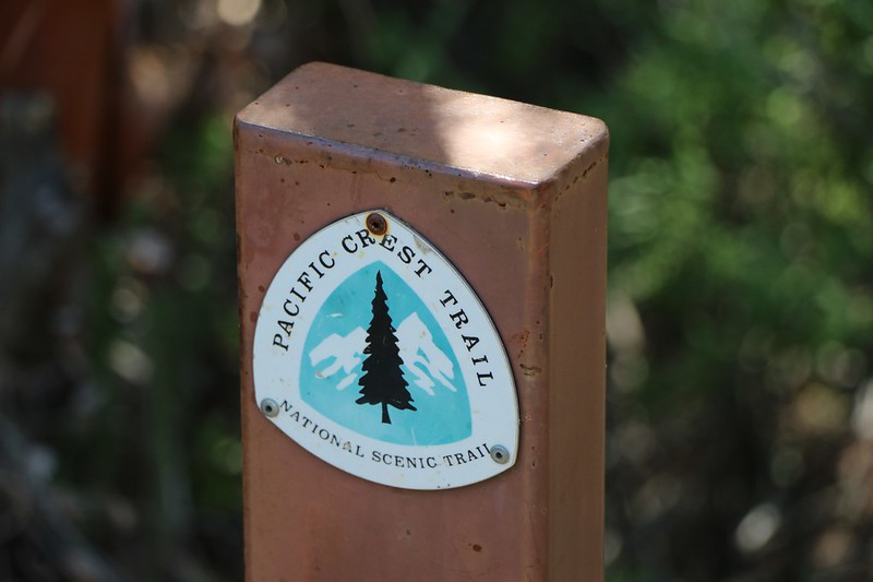 Older riveted PCT sign on a welded steel post