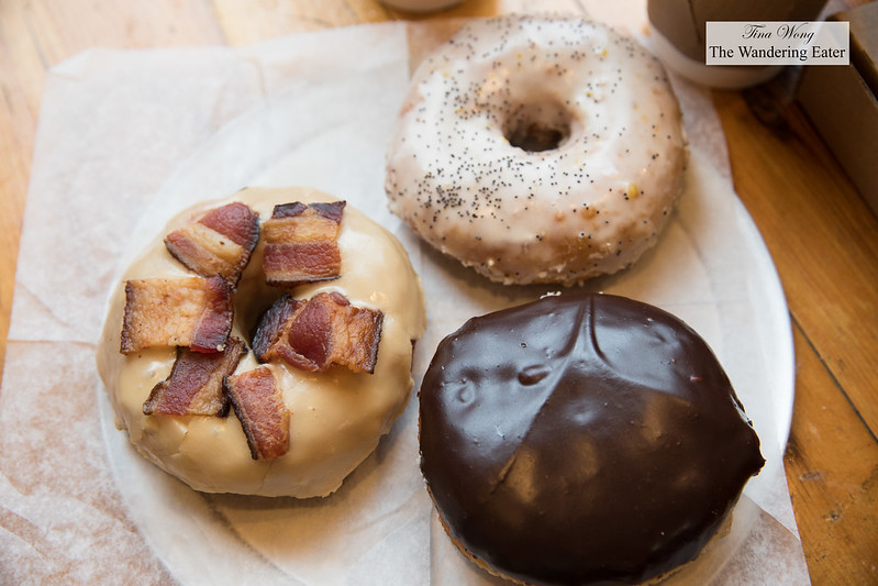 Plate of doughnuts - Maple Bacon, Boston Cream, and Orange Cardamom Poppy