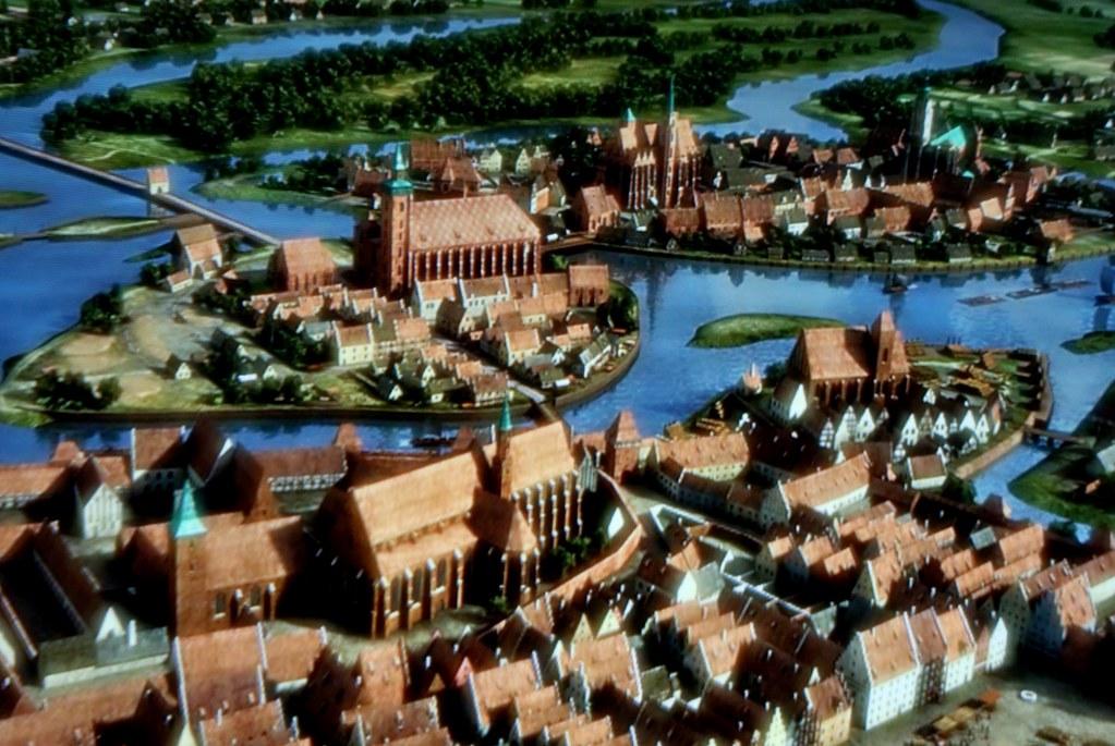 Animation illustrant Wroclaw au Moyen Age : Ici les iles sur le fleuve au nord de la Vieille Ville. Musée d'histoire de Wroclaw.