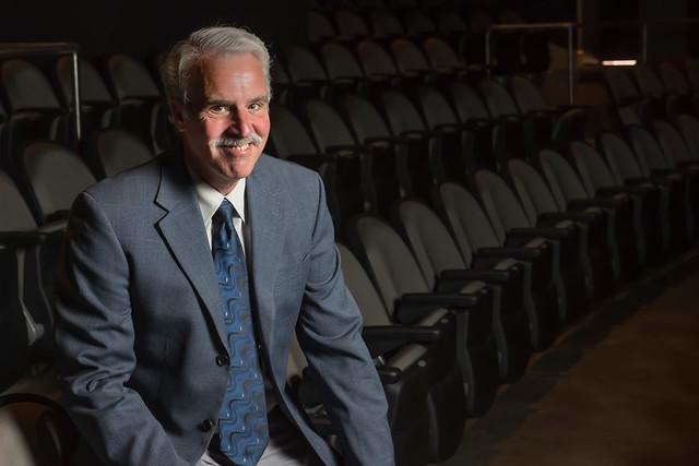 Theatre Professor Dan LaRocque sits in the seats at the Telfair Peet Theatre.