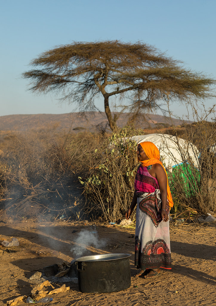 Woman cooking during the Gada system ceremony in Borana tr