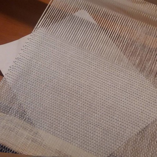 I am weaving my first transparent fabric. I'm using an Ashford rigid heddle loom. The yarn is 22/2 Cottolin with a 15 dent reed. I am going to do some inlays. I don't know what yet. Maybe clouds or simple blocks. A palm frond would be nice. We'll see. :)