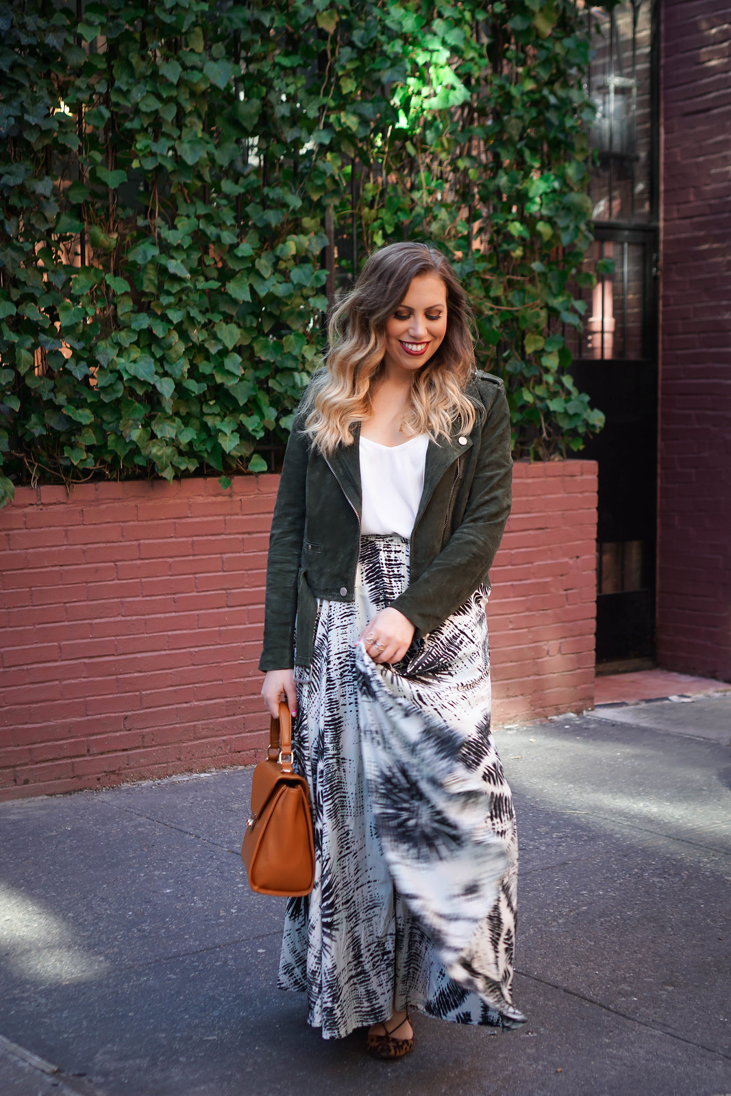 Printed Maxi Skirt | Olive Suede Moto Jacket | Curly Blonde Hair | Urban Decay Vice Liquid Lipstick in 714 | Spring NYC Outfit