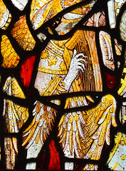 feathered angel playing a harp (15th Century)