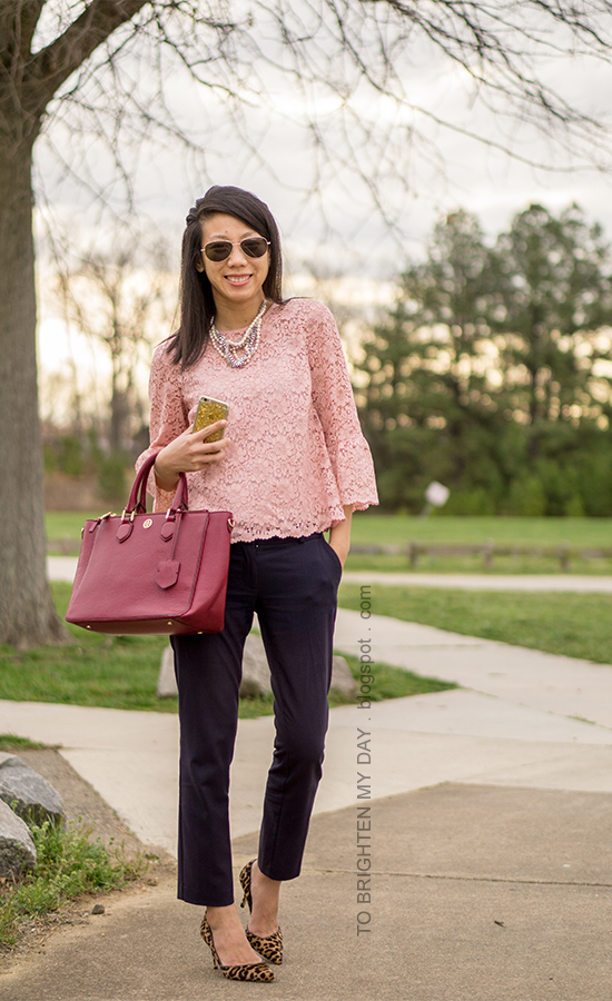 mixed pearl necklace, pink lace top with bell sleeves, navy ankle pants, burgundy tote, leopard pumps