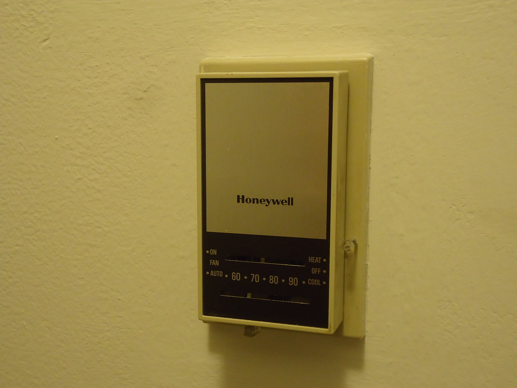 honeywell thermostat this thermostat in the hallway of. Black Bedroom Furniture Sets. Home Design Ideas
