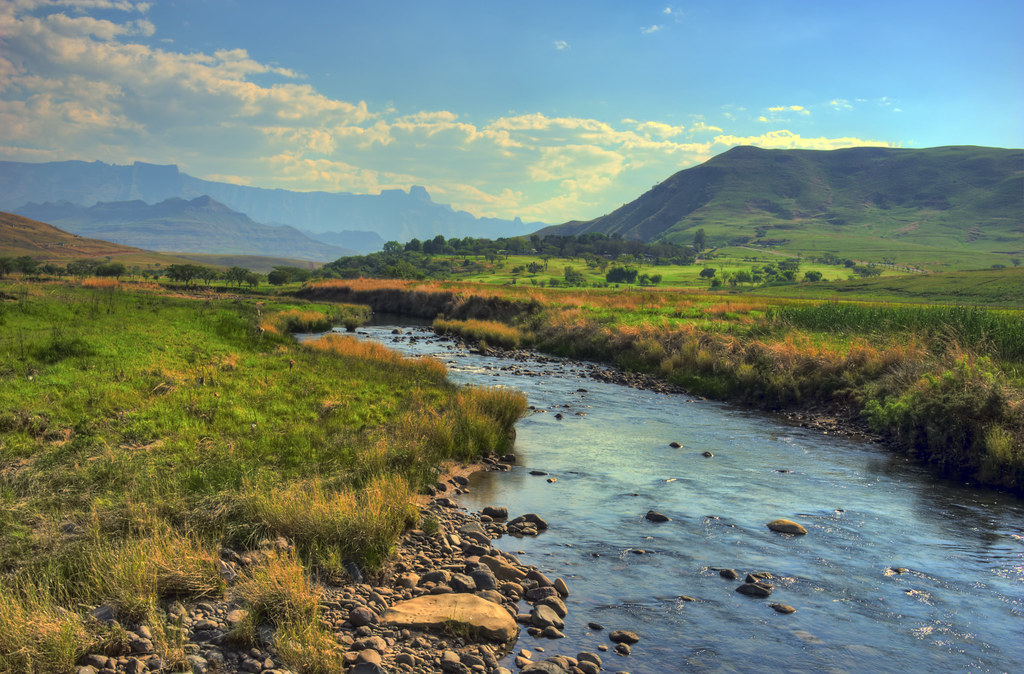 River in the mountains a landscape of the drakensberg moun for Landscape sa